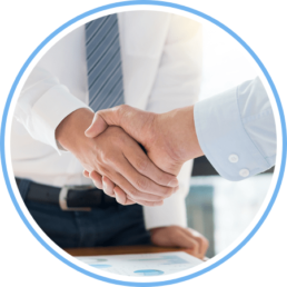 close up of two men shaking hands